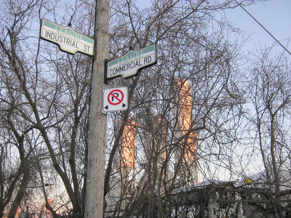 Signpost at corner of Industrial St and Commercial Rd in Leaside